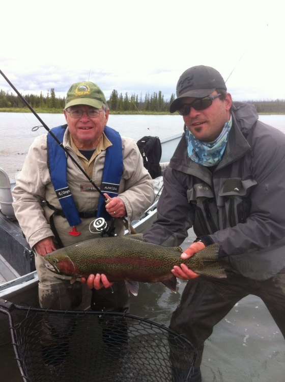 "Brian Pollock caught this rainbow trout Monday on the Kenai River. Estimated 10.08 pounds, 28"" length, 15"" girth. On an artificial leech."