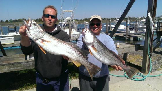 Mark and Cj show today's tide-runner weakfish.