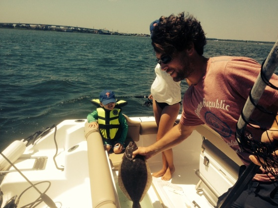 Ty McDermott checks out one of today's back bay keeper summer flounder.