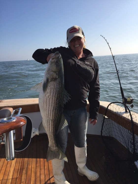 Missy Alcorn shows a nice striped bass. She caught this striper just south of Cape May.